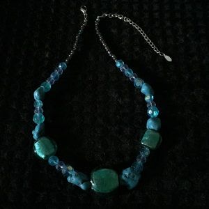 Turquoise colored beaded necklace.